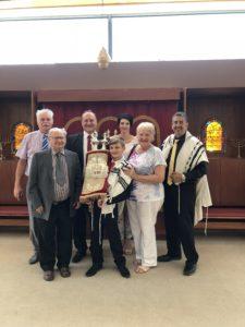 Brandon Chatzkelowitz, the Chatzkelowitz family and Rabbi Schell at Brandon's BarMi.